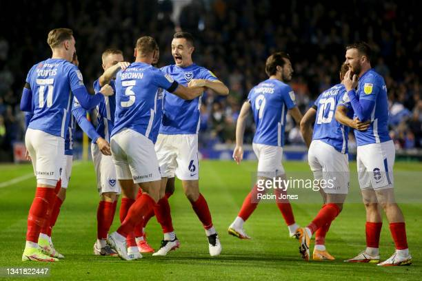 Shaun Williams congratulates team-mate Lee Brown of Portsmouth FC after he scores a goal to make it 1-0 during the Sky Bet League One match between...