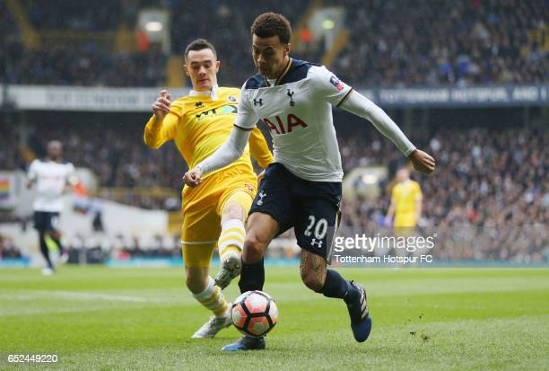Shaun Williams of Millwall puts pressure on Dele Alli of Tottenham Hotspur during The Emirates FA Cup QuarterFinal match between Tottenham Hotspur...