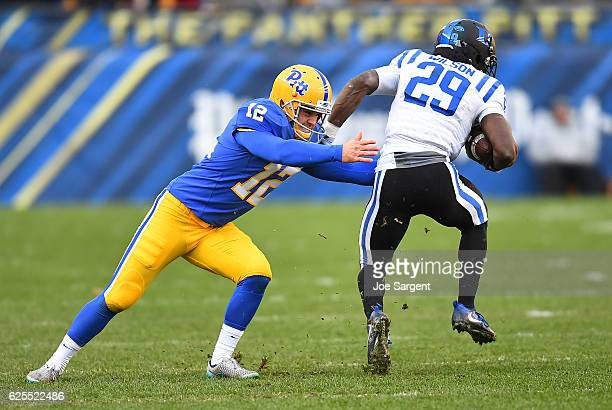 Shaun Wilson of the Duke Blue Devils gets tackled by Chris Blewitt of the Pittsburgh Panthers at Heinz Field on November 19 2016 in Pittsburgh...