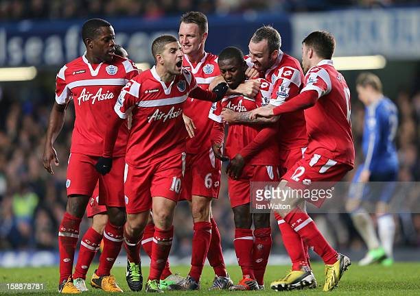 Shaun Wright Phillips of Queens Park Rangers with team mates after he scores the opening goal during the Barclays Premier League match between...