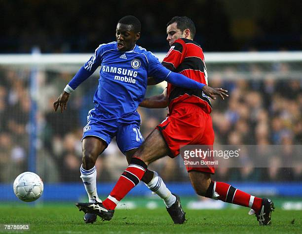 Shaun WrightPhillips of Chelsea holds off the challenge of Chris Barker of Queens Park Rangers during the FA Cup sponsored by EON 3rd Round match...
