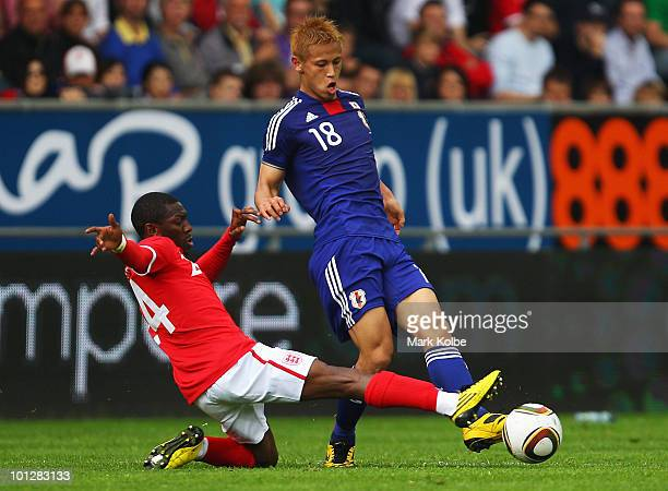 Shaun WrightPhillips of England attempts to tackle Keisuke Honda of Japan during the International Friendly between Japan and England at UPCArena on...