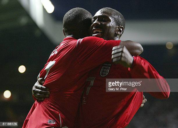 Shaun WrightPhillips of England celebrates with Jermaine Defoe after scoring the Third goal during the International friendly match between England...