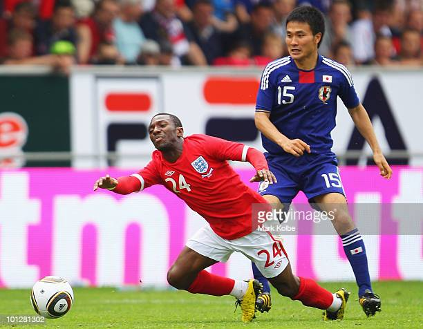Shaun WrightPhillips of England falls as he is tackled by Yasuyuki Konno of Japan during the International Friendly between Japan and England at...