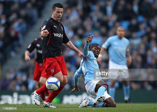 Shaun WrightPhillips of Manchester City is tackled by Ian Harte of Reading during the FA Cup sponsored by EOn Sixth Round match between Manchester...