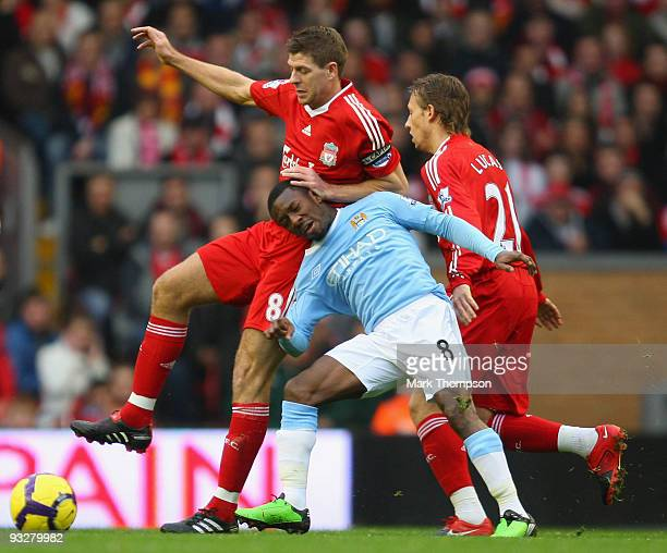 Shaun WrightPhillips of Manchester City tangles with Steven Gerrard of Liverpool during the Barclays Premier League match between Liverpool and...