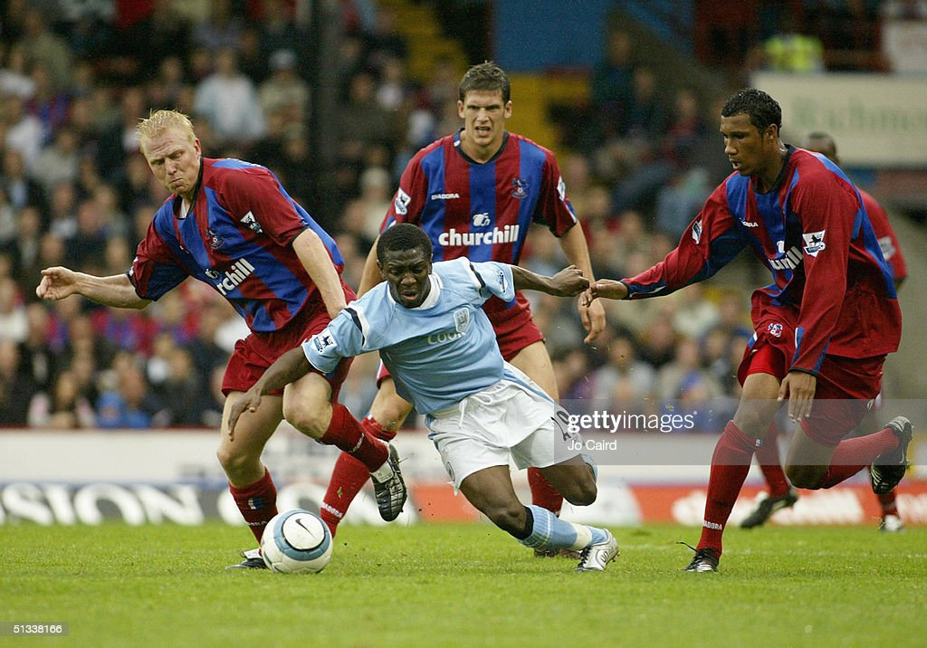 Shaun Wright-Phillips of Manchester City watched by Aki Riihilahti Mark Hudson and Fitz Hall of Crystal Palace during the Barclays Premiership match between Crystal Palace and Manchester City at Selhurst Park on September 18, 2004 in London, England.