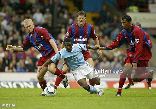 Shaun WrightPhillips of Manchester City watched by Aki Riihilahti Mark Hudson and Fitz Hall of Crystal Palace during the Barclays Premiership match...