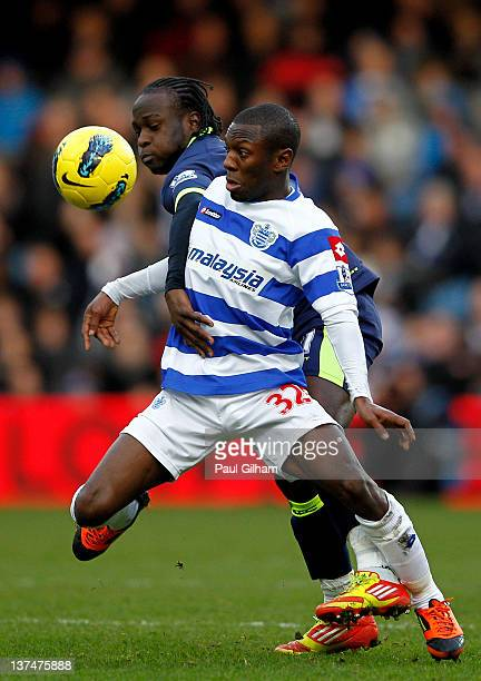 Shaun WrightPhillips of QPR is challenged by Victor Moses of Wigan during the Barclays Premier League match between Queens Park Rangers and Wigan...