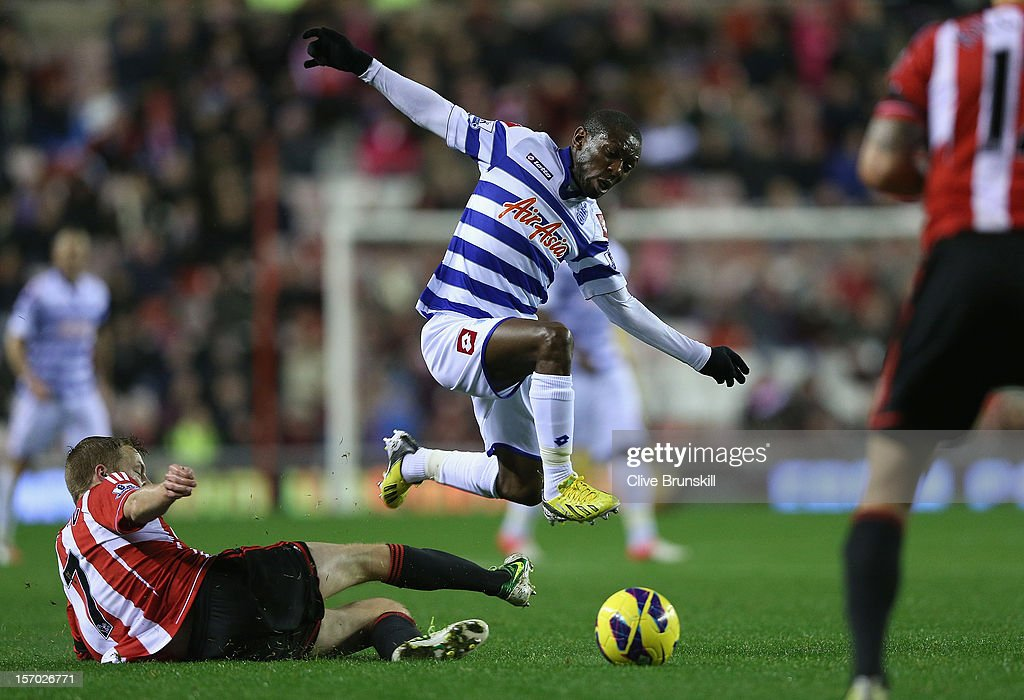 Shaun Wright-Phillips of Queens Park Rangers leaps over Sebastian Larsson of Sunderland during the Barclays Premier League match between Sunderland and Queens Park Rangers at the Stadium of Light on November 27, 2012, in Sunderland, England.