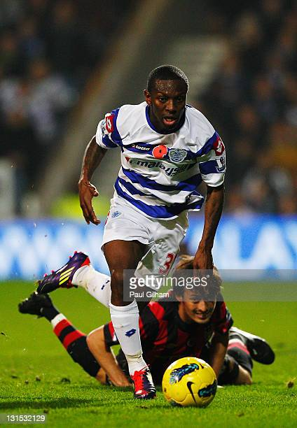 Shaun WrightPhillips of Queens Park Rangers shakes off the challenge of David Silva of Manchester City during the Barclays Premier League match...