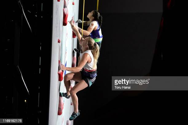 Shauna Coxsey of Great Britain and Miho Nokana of Japan compete in the Speed during Combined Women's Final on day ten of the IFSC Climbing World...
