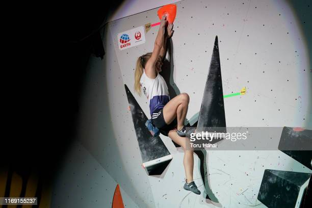 Shauna Coxsey of Great Britain celebrates as she competes in the Bouldering during Combined Women's Final on day ten of the IFSC Climbing World...