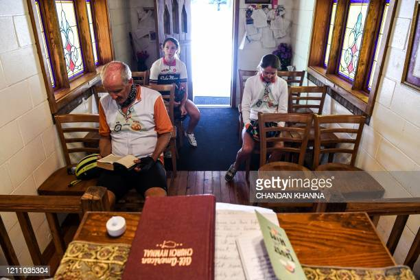 "Shauna Swain Riggs , Amelia Durst , David Crane offer prayers inside the ""Smallest Church In America"" in Townsend, Georgia, amid the novel..."