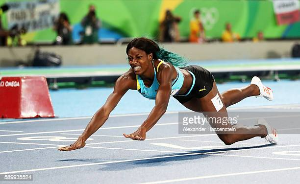 Shaunae Miller of the Bahamas dives over the finish line to win the gold medal in the Women's 400m Final on Day 10 of the Rio 2016 Olympic Games at...
