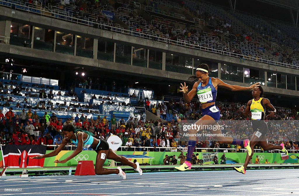 Shaunae Miller of the Bahamas (L) dives over the finish line to win the gold medal in the Women's 400m Final ahead of silver medalist Allyson Felix of the United States (C) and bronze medalist Shericka Jackson of Jamaica (R) on Day 10 of the Rio 2016 Olympic Games at the Olympic Stadium on August 15, 2016 in Rio de Janeiro, Brazil.