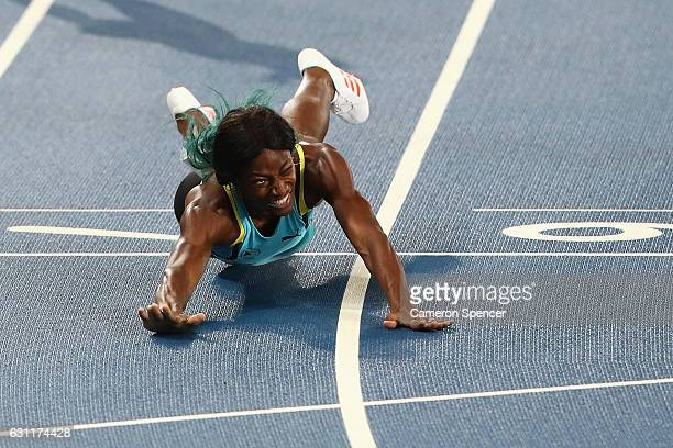 Shaunae Miller of the Bahamas falls over the finish line to win the gold medal in the Women's 400m Final ahead of silver medalist Allyson Felix of...