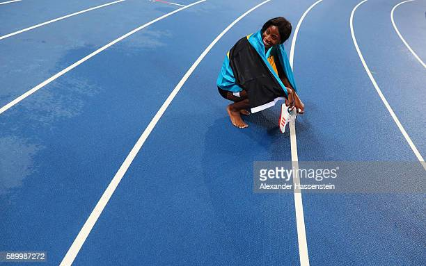 Shaunae Miller of the Bahamas reacts after winning the gold medal in the Women's 400m Final on Day 10 of the Rio 2016 Olympic Games at the Olympic...