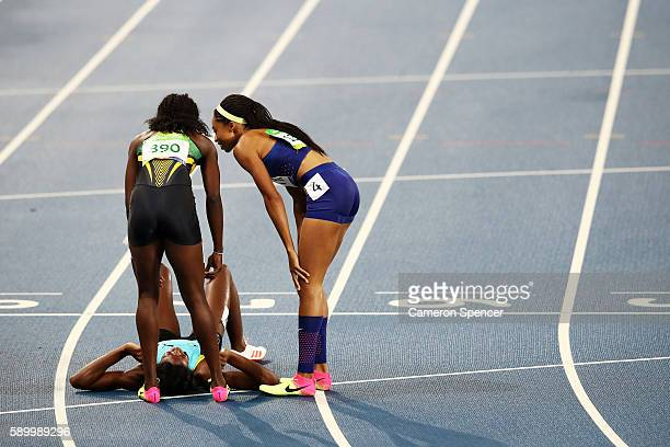 Shaunae Miller of the Bahamas reacts after winning the gold medal in the Women's 400m Final as bronze medalist Shericka Jackson of Jamaica and silver...
