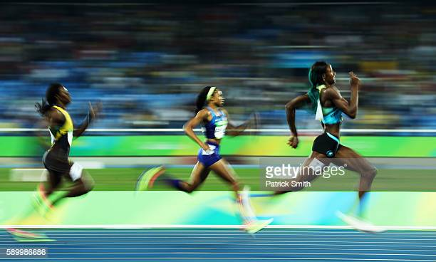 Shaunae Miller of the Bahamas runs on her way to winning the gold medal in the Women's 400m Final ahead of silver medalist Allyson Felix of the...