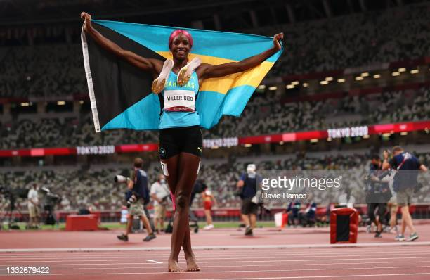 Shaunae Miller-Uibo of Team Bahamas celebrates after winning the gold medal in the Women's 400m Final on day fourteen of the Tokyo 2020 Olympic Games...