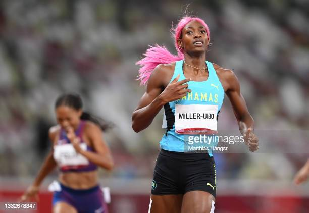 Shaunae Miller-Uibo of Team Bahamas crosses the line to win the gold medal during the Women's 400 metres final on day fourteen of the Tokyo 2020...