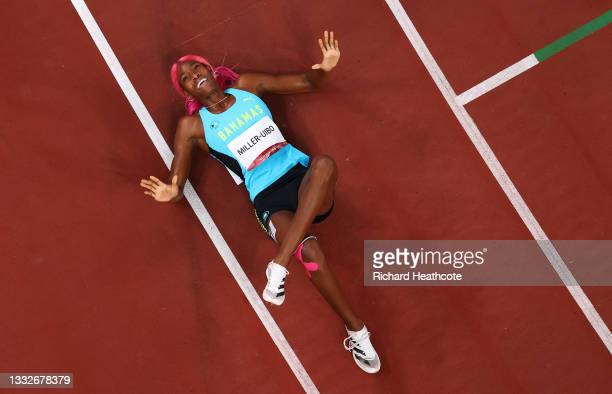 Shaunae Miller-Uibo of Team Bahamas reacts after winning the gold medal in the Women's 400m Final on day fourteen of the Tokyo 2020 Olympic Games at...