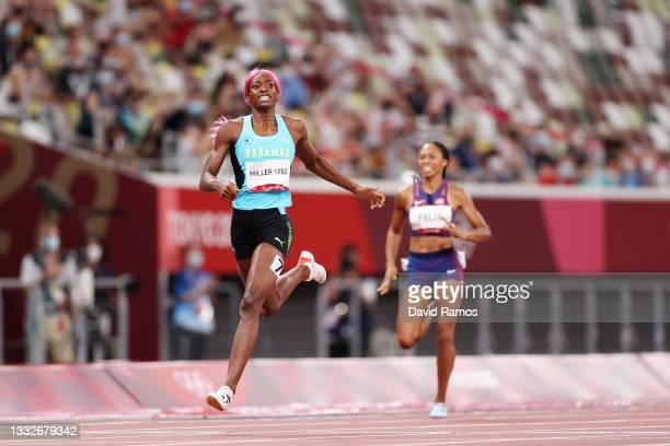 Shaunae Miller-Uibo of Team Bahamas reacts as she crosses the finish line winning the gold medal in the Women's 400m Final on day fourteen of the...
