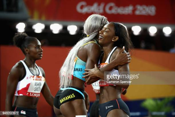 Shaunae MillerUibo of the Bahamas celebrates winning gold with Bianca Williams of England in the Women's 200 metres final during athletics on day...