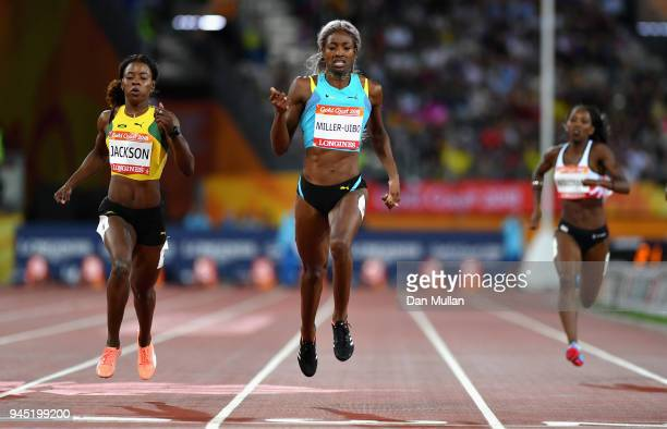 Shaunae MillerUibo of the Bahamas crosses the line to win gold ahead of Shericka Jackson of Jamaica in the Women's 200 metres final during athletics...