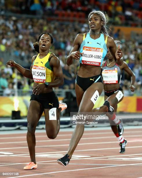 Shaunae Miller-Uibo of the Bahamas crosses the line to win gold ahead of Shericka Jackson of Jamaica in the Women's 200 metres final during athletics...