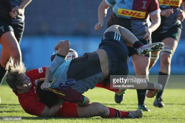 Shaunagh Brown of Harlequins Ladies is tackled by Marlie Packer of Saracens Women during the Tyrrells Premier 15s match between Harlequins Ladies and...
