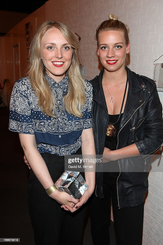 Shauni Douglas and Olivia Creber from Edinburgh College of Art win the Menswear Award at the gala awards show for Graduate Fashion Week 2013 at Earls Court 2 on June 5, 2013 in London, England.