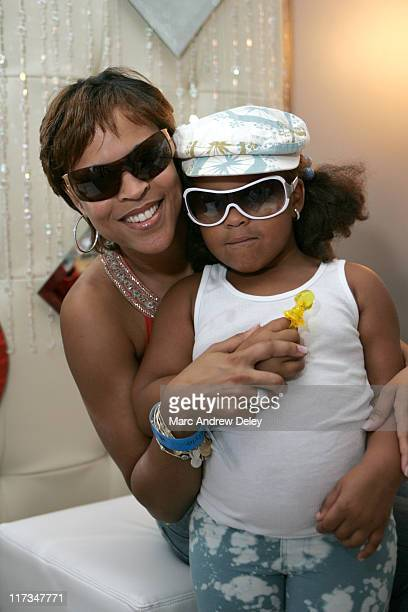 Shaunie O'Neal and daughter Amirah Sanaa wearing Versace 2034 and Alicia Malone wearing Versace 2362
