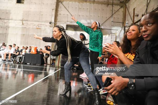 Shaunie O'Neal cheers on her son Shareef O'Neal of Crossroads High school against Beverly Hills High school at the Jordan Brand Future of Flight...