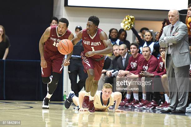 Shavar Newkirk of the Saint Joseph's Hawks dribbles up court during a college basketball game against the George Washington Colonials at Charles E...