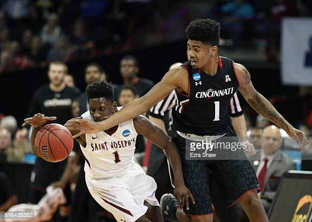 Shavar Newkirk of the Saint Joseph's Hawks steals the ball from Jacob Evans of the Cincinnati Bearcats in the first half during the first round of...