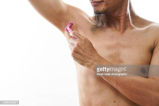 shave armpit hair - armpit hair stock pictures, royalty-free photos & images