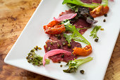 appetizer shaved beef carpaccio with lettuce
