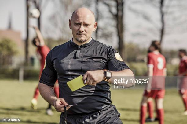 shaved handsome caucasian male soccer referee during a football match - referee stock pictures, royalty-free photos & images