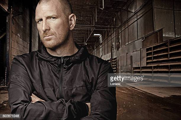 Shaved redhead man posing in urban location