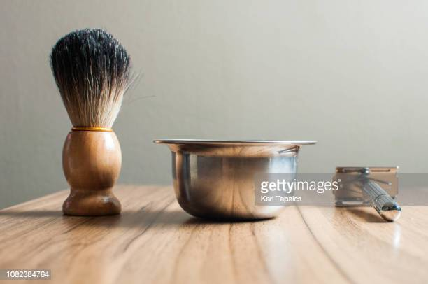 shaving accessories on a wooden table - shaving brush stock photos and pictures