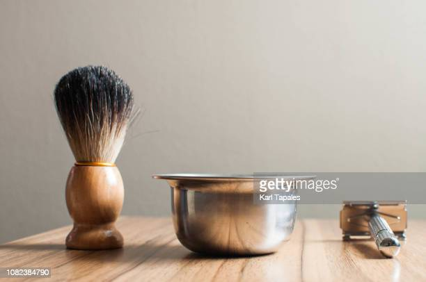 Shaving accessories on a wooden table