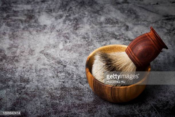 shaving brush and wooden bowl on black background - masculinity stock pictures, royalty-free photos & images