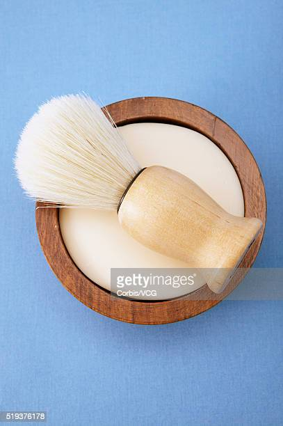 shaving brush on shaving soap - shaving brush stock photos and pictures