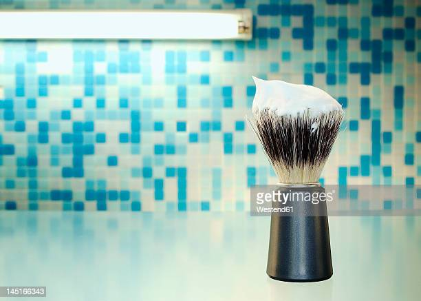 shaving brush with foam, close up - shaving brush stock photos and pictures