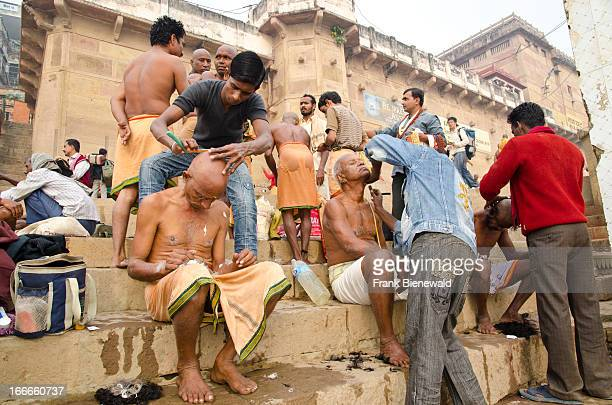 Shaving head and beard is part of the ritual to pray farewell for the soul of a died person Seen at the ghats of Varanasi