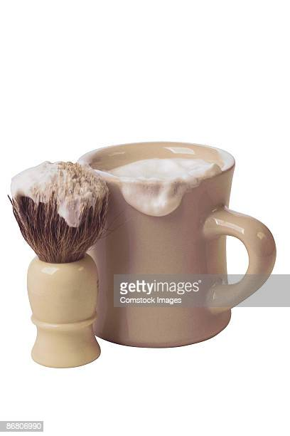 shaving mug and brush with shaving cream - shaving brush stock photos and pictures