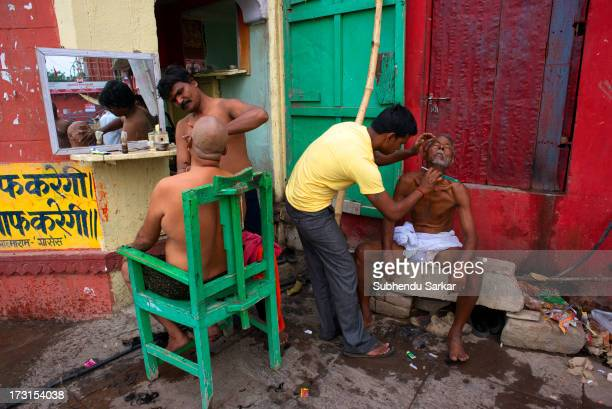 Shaving on the ghats of the Ganges in Varanasi, India