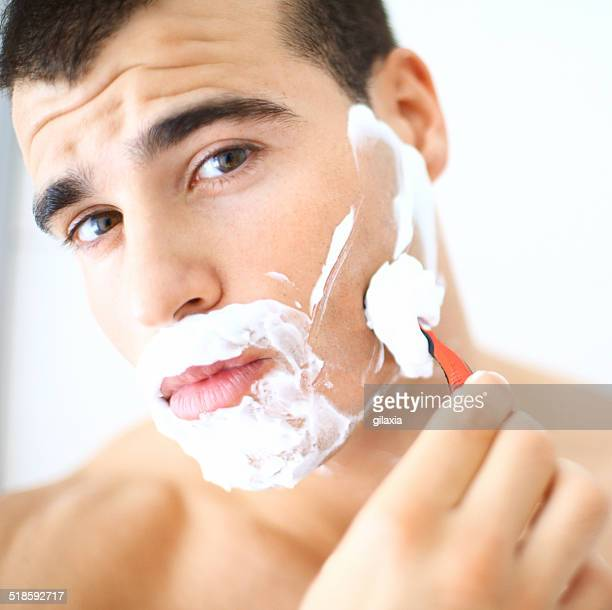 shaving. - shaving cream stock photos and pictures